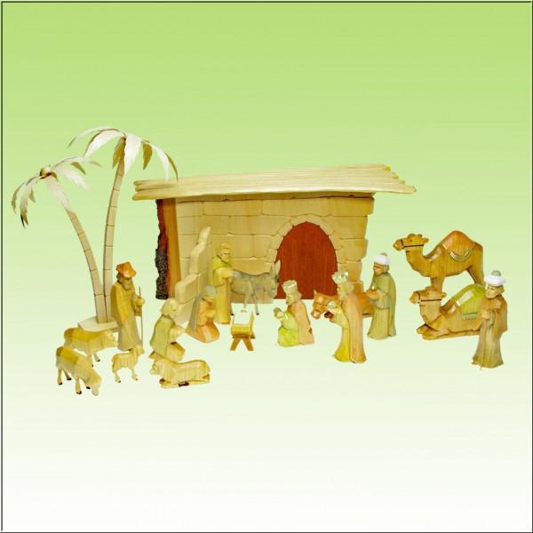 geschnitzte Weihnachtskrippe, 17 Figuren, Krippenstall mit Rindenkante u. Palmen