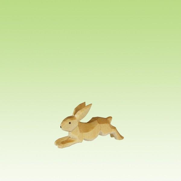 geschnitzter Hase, flüchtend