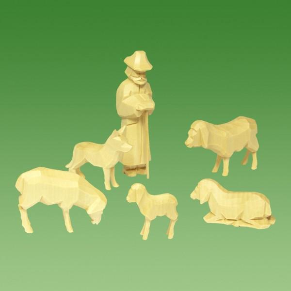 geschnitzter Schäfer mit Schafen und Hund