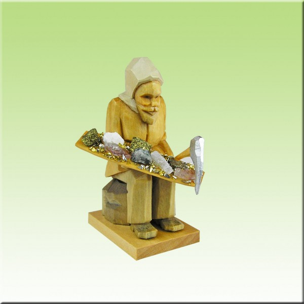 geschnitzter Bergmann, sitzend m. Erzschale, 7cm, farbig lasiert